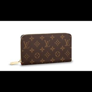 Louis Vuitton Monogram Clarence Wallet (fuschia)
